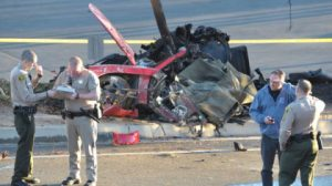 """Sheriff's deputies work near the wreckage of a Porsche that crashed into a light pole on Hercules Street near Kelly Johnson Parkway in Valencia, Calif., on Saturday, Nov. 30, 2013. A publicist for actor Paul Walker says the star of the """"Fast & Furious"""" movie series died in the crash north of Los Angeles. AP"""