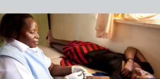 A nurse at a hospital in the Kasama district of northern Zambia prepares to insert a birth control implant.