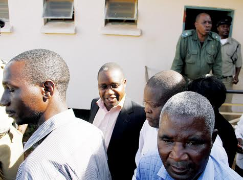 MMD Chisamba member of Parliament Moses Muteteka (background) is led to a waiting vehicle after he was sentenced to five years in prison with hard labour yesterday. – Picture by MACKSON WASAMUNU