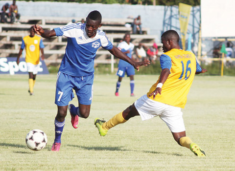 Nkwazi striker Augustine Mulenga (left) beats Napsa Stars' Patrick Mwansa during the MTN Super Division Week 30 match at Lusaka's Woodlands Stadium