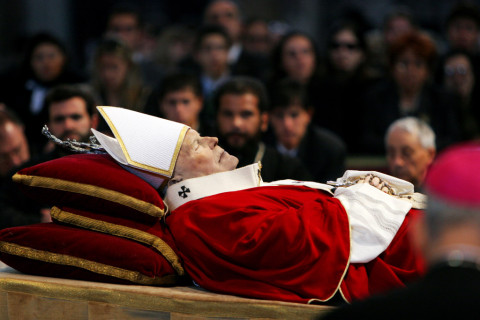 The late Pope John Paul II lay in state the day before his funeral on Thursday, April 7, 2005. Pilgrims and clergy filed through the church to pay their last respects at the Vatican. April 7, 2005. Photo by Fabrizio Costantini