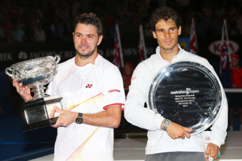 Stanislas Wawrinka of Switzerland poses with Norman Brookes Challenge Cup after defeating Rafael Nadal