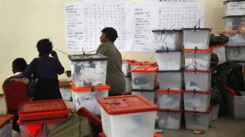 2011, Election volunteers stand by ballot boxes stored at the Civic Center in Lusaka, Zambia.jpg