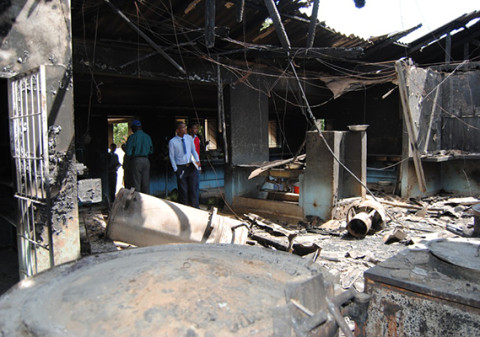 A PUPIL looks at the remains of the kitchen gutted by fire at Choma Secondary School yesterday. – Picture By CHOMBA MUSIKA.jpg