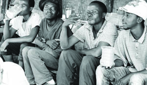 A group of men enjoys a local brew during the early hours of a working day.