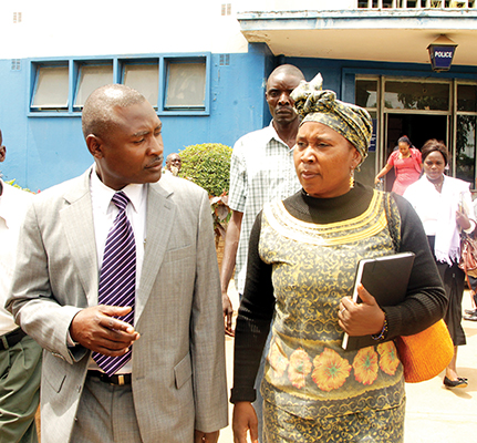 ABZ vice-president Patricia Mwashingwele (right) with party president Frank Bwalya at Lusaka Central Police station yesterday where she was warned and cautioned for bouncing a cheque. – Picture by UYOYA NDIMBA.