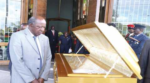 ACTING President Alexander Chikwanda views the body of the late High Commissioner to Malaysia Miles Banda during a church service held at the Cathedral of the Holy Cross in Lusaka yesterday. Picture by CLEVER ZULU
