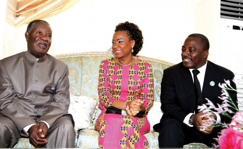 DEMOCRATIC Republic of Congo President Joseph Kabila (right) and his wife madam Marie Olive Lembe Kabila with President Sata at State House in Kinshasa wait for other visiting heads of state attending the Seventh COMESA Summit. - Picture by EDDIE MWANALEZA.