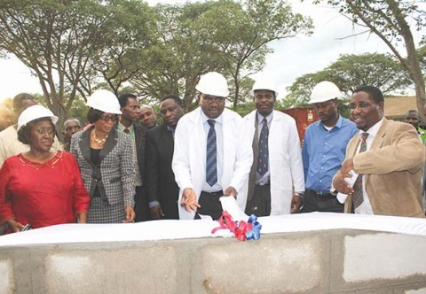 DEPUTY Health Minister Chitalu Chilufya (middle) unveiling the foundation for the construction of the first district hosiptal in Kazungula. – Picture by NANCY MWAPE.