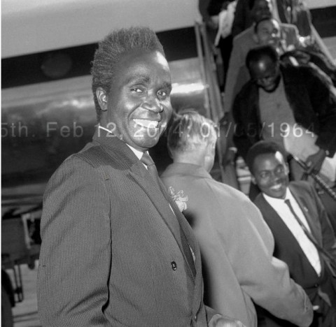Dr Kenneth Kaunda, the first Prime Minister of Northern Rhodesia, arrives at london Airport to lead his Government's delegation at the Northern Rhodesia Independence Conference