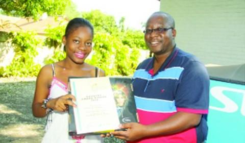 First Zambian finalist in the DStv Eutelsat Star Awards, Francine Mazala (left) with Multichoice public relations manager Marlon Kananda.