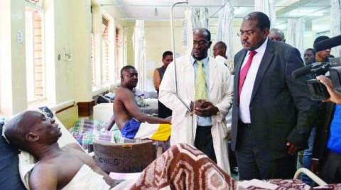 HEALTH Deputy Minister Chitalu Chilufya visits one of the Feb 21st Mazabuka accident victims evacuated to the University Teaching Hospital in Lusaka yesterday. Picture by KAIKO NAMUSA