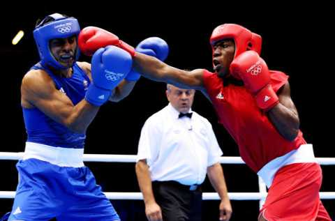 Jeffrey Horn of Australia (L) in action with Gilbert Choombe of Zambia during their Men's Light Welter (64kg) Boxing bout