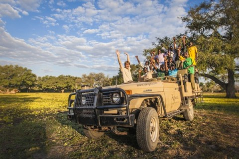 Mario Vos from Kafunta Safaris on a game drive with local children for Kids in the Wild. (Photograph by Marcus and Kate Westberg)