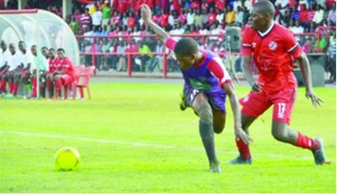NKANA midfielder, Kelvin Mubanga (right) battles for the ball with Njabulo Ndlovu of Swaziland's Mbabane Swallows