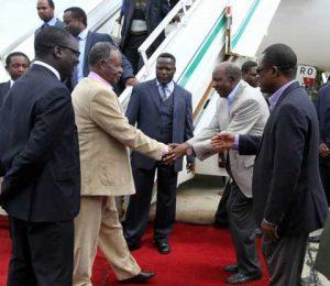 President Michael Sata greets Finance minister Alexander Chikwanda on arrival at Kenneth Kaunda International Airport -Picture by EDDIE MWANALEZA