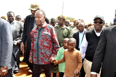 President Michael Sata with Maya Sibande and Square Lungu (in green) on arrival in Katuba Constituency to drum up Support for PF parliamentary candidate Moses Chilando on Feb 15, 2014 -Picture by THOMAS NSAMA