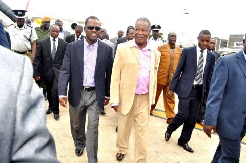 President Sata flanked by Justice minister Wynter Kabimba on arrival at Kenneth Kaunda International Airport from London on Feb 8,2014 -Picture by THOMAS NSAMA