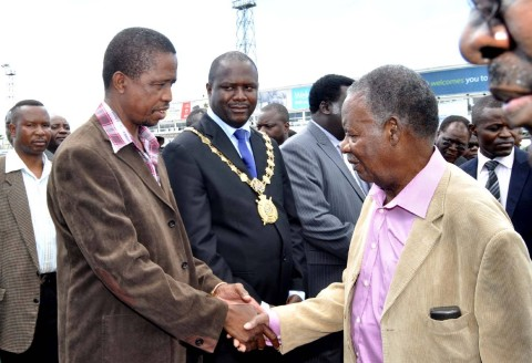 President Sata greets Defence minister Edgar Lungu on arrival at Kenneth Kaunda International Airport in Lusaka from London on Feb 8,2014 -Picture by THOMAS NSAMA