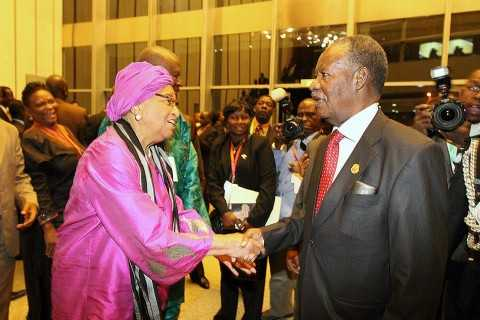 Sata Exchanging greetings with Liberian Leader Ellen Johnson Sirleaf during the closing ceremony — in Addis Ababa, Ethiopia