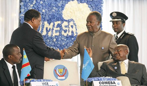 PRESIDENT Michael Sata (right) shakes hands with COMESA Secretary-General Sindiso Ngwenya after the Zambian Head of State delivered a keynote speech at the summit in Kinshasa yesterday as host President Joseph Kabila (left) and Ugandan leader Yoweri Museveni look on. Picture By EDDIE MWANALEZA/State House