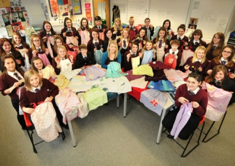 Students and teacher Stephanie Fraser at Cromwell Community College with the dresses made from pillow cases to send to Africa, for the children at Chisokone school.