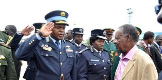ZAF Commander Lt Gen Chimese salutes President Sata when he arrived at Kenneth Kaunda International Airport from London on Feb 8,2014 -Picture by THOMAS NSAMA