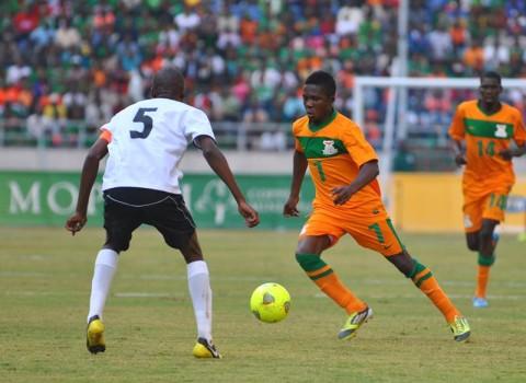 ZAMBIA midfielder Bruce Musakanya (right) tries to veer past Mumpati Thuma of Botswana