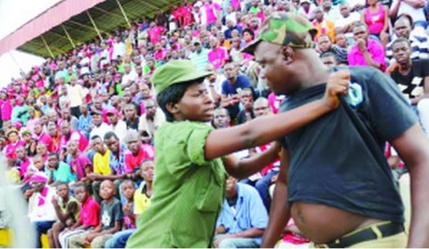 A Police officer roughs up a suspected Nkana fan during the 2014 CAF Champions League first round, first leg match against Kampala City Council Authority (KCCA) at Arthur Davies Stadium in Kitwe at the weekend. The teams drew 2-2
