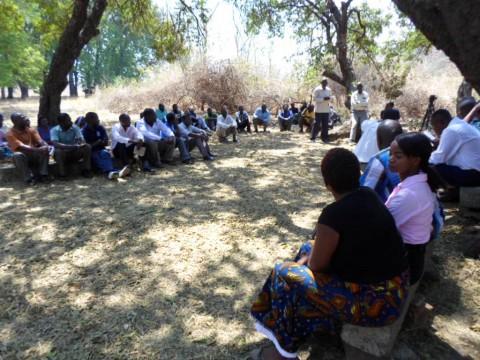 Agriculture Deputy Minister Rodgers Mwewa, Mazabuka District Commissioner Eugene Munyama, scientists and officials address displaced farmers in Mazabuka - Photo Credit - Paul Shalala