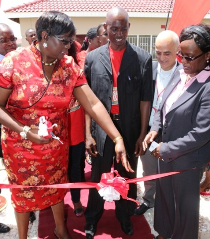 """Airtel MD Charity Chanda Lumpa at the handover of the house won by Lovemore Mulenga during the ongoing """"Wina Biga"""" promotion at the North Gate Garden"""