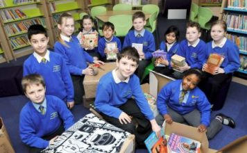 Pupils at St Stephen and All Martyrs' School packing books for their partner school in Zambia