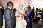 Zimbabwean President Robert Mugabe and First Lady Grace Mugabe during the wedding ceremony of their daughter Bona Mugabe and her husband Simba