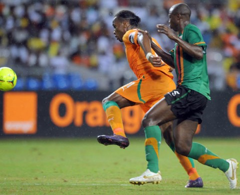 Hichani Himoonde of Zambia battles with Didier Drogba of Ivory Coast