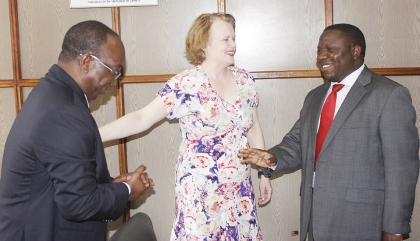 UNITED Nations residentcoordinator and UNDP resident representative Janet Rogan (middle) introduces World Health Organisation representative DrOlusegunBabaniyi whenshe presented her letter of credence to Ministerof Foreign Affairs Harry Kalaba at his office in Lusaka yesterday. – Picture by CHANDA MWENYA.