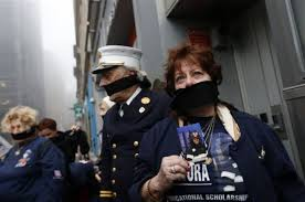 Al Santora, center, father of firefighter Christopher Santora, a victim of the September 11, 2001, terrorist attacks, and other victims' family members protest the decision by city officials to keep unidentified human remains of the victims at the National September 11 Memorial Museum at the World Trade Center site May 10, 2014, in New York City.