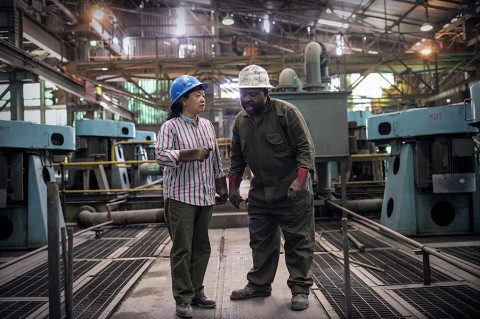 A Chinese operations manager in conversation with one of the Zambian staff at the NFCA's (Non-Ferrous Company Africa) Chambishi copper mine.