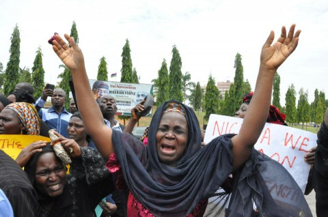A mother cries out during a demonstration with others who have daughters among the kidnapped