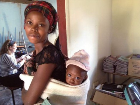 A woman and her baby in Zambia, Africa near the capital city Lusaka where engineer Dorothy Timian-Palmer has worked to help design a method to secure clean water.