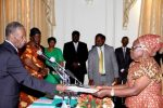 President Sata receives an affidavit of Oath from Zambia's Ambassador to Malawi Salome Mwananshiku during the Swearing-in-ceremony at State House on May 30,2014 -Picture by THOMAS NSAMA