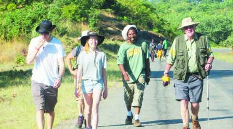 DAVID Lemon (right) joined by well-wishers among them Zambian artist Alexis Phiri at the start of his second leg Zambezi Cowbell Trek in Siavonga last month. Picture Courtesy of Promasidor