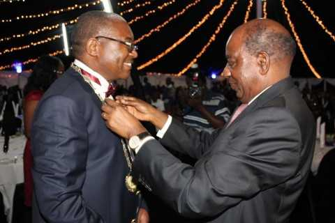 Induction of the new ZICA President Mr. Wesley Beene (left) by the Minister of Finance Hon. Alexander Chikwanda (right).