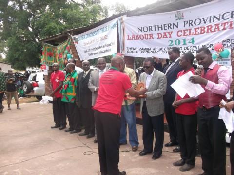 Kabimba presenting an award — in Kasama, Zambia.