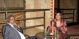 Lameck Mangani having a drink with former Lands Minister Judith kapijimpanga - Photo Credit - thepicturemonger