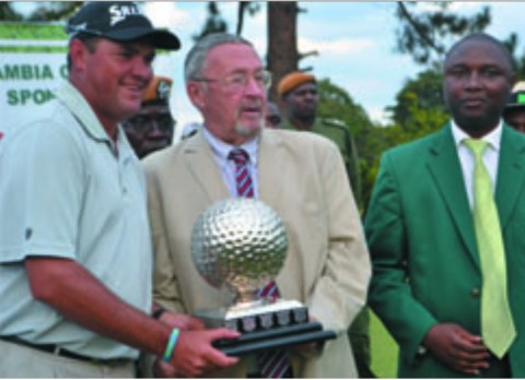 MOPANI Copper Mines 2014 Zambia Open Champion Willie Coetsee of South Africa hoists the trophy after it was presented to him by Vice-President Guy Scott (centre) - lusakavoice.com