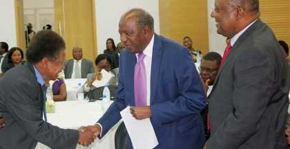 Minister of Finance Alexander Chikwanda(middle) greets Sudanese ambassador Issa Edem during the launch of the African Development Bank 50th anniversary at Government Complex on Tuesday