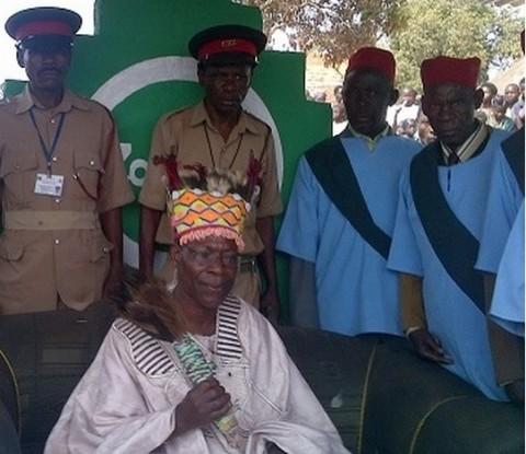 Senior Chief Mununga, Mutampuka II Chula I, sitting surrounded by his retainers and advisors during the 2013 Mabila Ceremony.