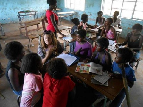 Katie Costello works with some of the girls in one of the GLOW Camp small groups in a Zambian village. / Submitted