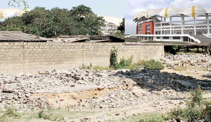 PICTURE combo: A Lusaka businessman has bought off 10 houses and demolition of the structures (left) has commenced to pave way for construction of a shopping mall opposite the National Heroes Stadium in Mandevu township. INSET: The newly-constructed stadium. – Picture by ANGELA MWENDA.
