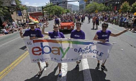 In this June 8, 2014, photo, workers carry an eBay banner during the gay pride parade, in Salt Lake City. . (AP Photo:Rick Bowmer)